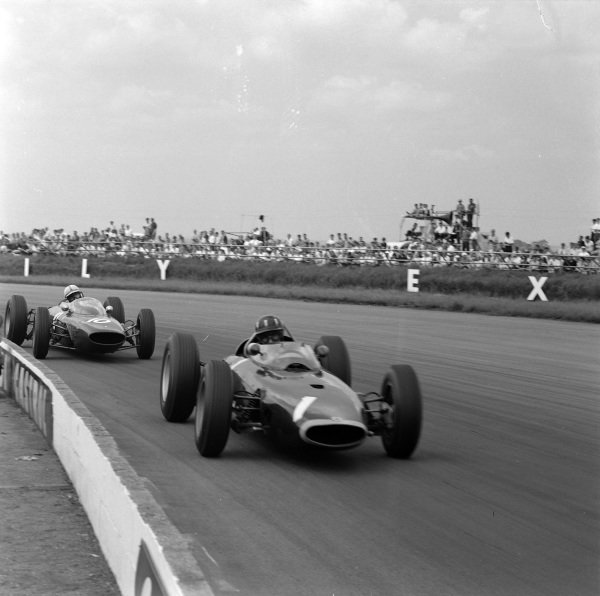 Graham Hill, BRM P57, leads John Surtees, Ferrari 156/63.