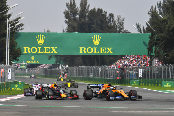 Carlos Sainz Jr., McLaren MCL34, leads Max Verstappen, Red Bull Racing RB15, and Sergio Perez, Racing Point RP19