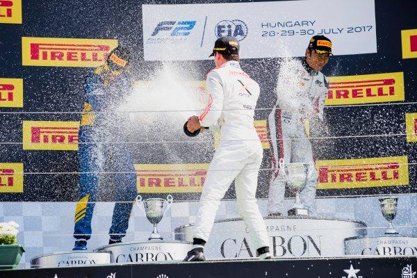 2017 FIA Formula 2 Round 7. Hungaroring, Budapest, Hungary. Sunday 30 July 2017. Oliver Rowland (GBR, DAMS), Nobuharu Matsushita (JPN, ART Grand Prix), Nyck De Vries (NED, Rapax).  Photo: Zak Mauger/FIA Formula 2. ref: Digital Image _54I4974