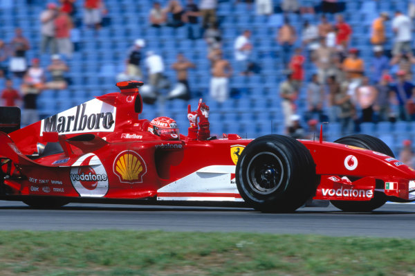 2004 German Grand PrixHockenheim, Germany. 23rd - 25th July.Michael Schumacher, Ferrari F2004 celebrates his victory on the slowing down lap. Action. World Copyright:Peter Spinney/LAT Photographic Ref:35mm Image:A17