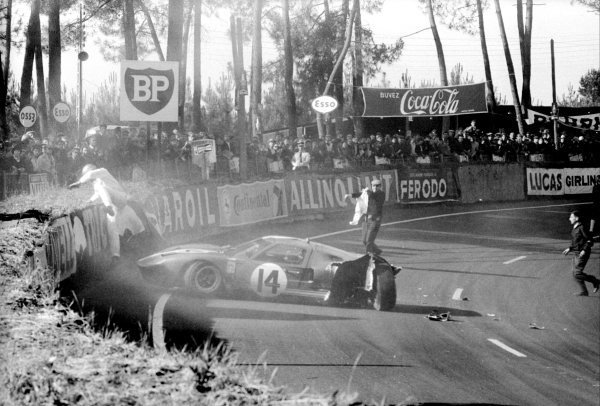 The Scuderia Filipinetti Ford GT40 of Peter Sutcliffe (GBR) and Dieter Spoerry (SUI) crashes out of the race. Le Mans 24 Hours Race, Le Sarthe, France, 19 June 1966.