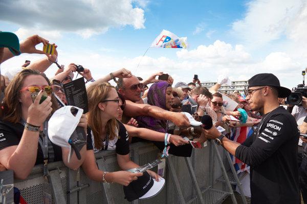 Silverstone Circuit, Northamptonshire, England. Saturday 4 July 2015. Lewis Hamilton, Mercedes AMG, signs autographs for fans. World Copyright: Steve Etherington/LAT Photographic ref: Digital Image SNE18842