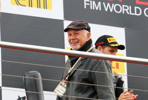 2015 World Superbike Championship.  Donington Park, UK.  23rd - 24th May 2015.  Singer David Essex presents trophies on the podium.  Ref: KW7_7211a. World copyright: Kevin Wood/LAT Photographic