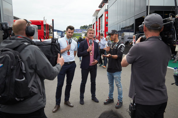 Red Bull Ring, Spielberg, Austria. Sunday 3 July 2016. Steve Jones, Presenter, Channel 4 F1, and David Coulthard, TV Commentator, Channel 4 F1, interview Lewis Hamilton, Mercedes AMG. World Copyright:Steve Etherington/LAT Photographic ref: Digital Image SNE18272