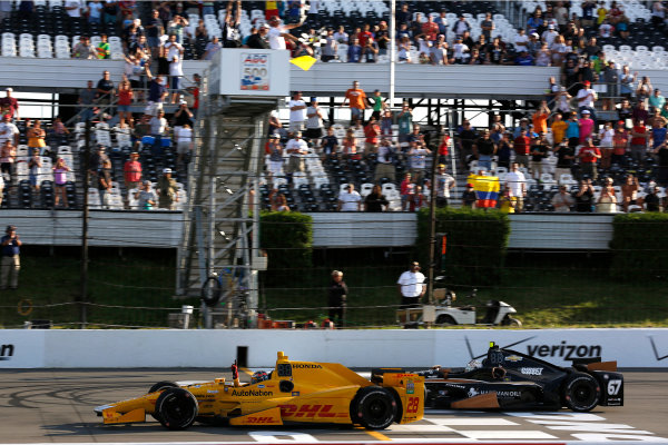22-23 August, 2015, Pocono, Pennsylvania, USA Winner Ryan Hunter-Reay takes the checkered flag and win © 2015, Phil Abbott LAT Photo USA