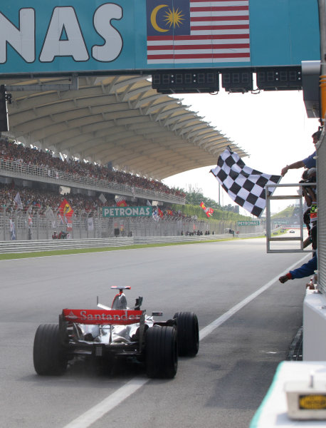 Sepang, Kuala Lumpur, Malaysia.8th April 2007Fernando Alonso, McLaren MP4-22 Mercedes, 1st position, crosses the line to take his first victory with the McLaren team. Action. Finish.World Copyright: Steve Etherington/LAT Photographicref: Digital Image WI2T1202