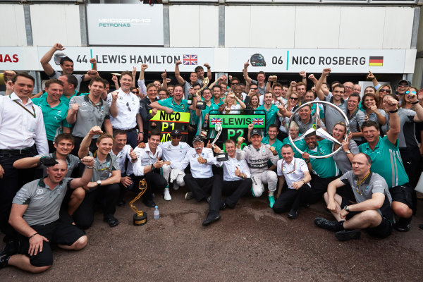 Monte Carlo, Monaco. Sunday 25 May 2014. Nico Rosberg, Mercedes AMG, 1st Position, Lewis Hamilton, Mercedes AMG, 2nd Position, Toto Wolff, Executive Director (Business), Mercedes AMG, Dr Dieter Zetsche, CEO, Mercedes Benz, Paddy Lowe, Executive Director (Technical), Mercedes AMG, and the Mercedes AMG team celebrate. World Copyright: Steve Etherington/LAT Photographic. ref: Digital Image SNE20217 copy