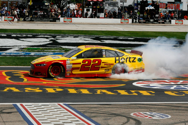 4-6 April, 2014, Fort Worth, Texas USA Joey Logano celebrates his win with a burnout ©2014, Russell LaBounty LAT Photo USA