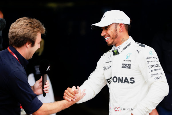 Autodromo Nazionale di Monza, Italy. Saturday 02 September 2017. Davide Valsecci interviews Lewis Hamilton, Mercedes AMG, after he secured a record breaking 69th Pole position. World Copyright: Zak Mauger/LAT Images  ref: Digital Image _56I7648