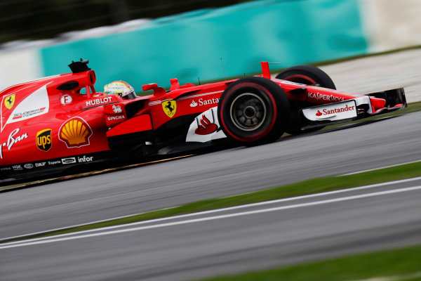 Sepang International Circuit, Sepang, Malaysia. Friday 29 September 2017. Sebastian Vettel, Ferrari SF70H, srikes up sparks. World Copyright: Zak Mauger/LAT Images  ref: Digital Image _56I1896