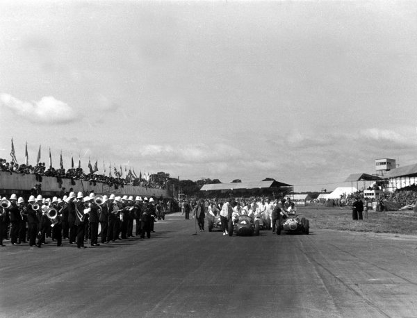 Silverstone, Great Britain. 17th July 1954.Cars are led onto the grid before the start of the race, atmosphere.World Copyright: LAT PhotographicRef: 4646A-17A/18
