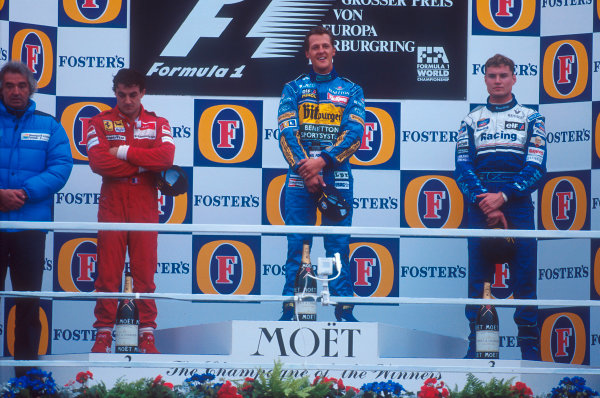 Nurburgring, Germany.29/9-1/10 1995.Michael Schumacher (Benetton Renault) 1st position, Jean Alesi (Ferrari) 2nd position and David Coulthard (Williams Renault) 3rd position on the podium. Flavio Briatore stands next to Alesi for the winning constructor. Ref-95 EUR 02.World Copyright - LAT Photographic