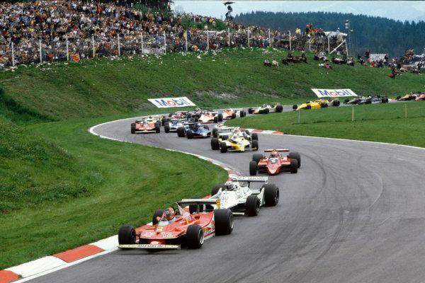 Osterreichring, Zeltweg, Austria.10-12 August 1979.Gilles Villeneuve (Ferrari 312T4) leads Alan Jones (Williams FW07 Ford) and Niki Lauda (Brabham BT48 Alfa Romeo) at the start. Ref-79 AUT 02.World Copyright: LAT Photographic