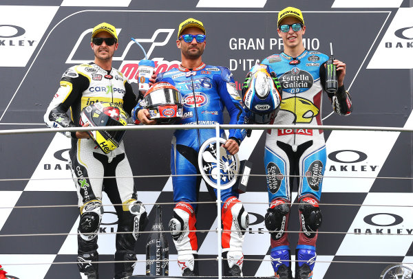 2017 Moto2 Championship - Round 6 Mugello, Italy Sunday 4 June 2017 Podium: second place Thomas Luthi, CarXpert Interwetten, Race winner Mattia Pasini, Italtrans Racing Team, third place Alex Marquez, Marc VDS race World Copyright: Gold & Goose Photography/LAT Images ref: Digital Image 674645
