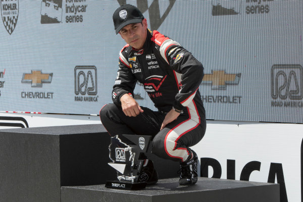 Verizon IndyCar Series Kohler Grand Prix Road America, Elkhart Lake, WI USA Sunday 25 June 2017 Helio Castroneves, Team Penske Chevrolet experienced discomfort during podium after finishing third World Copyright: Geoffrey M. Miller LAT Images