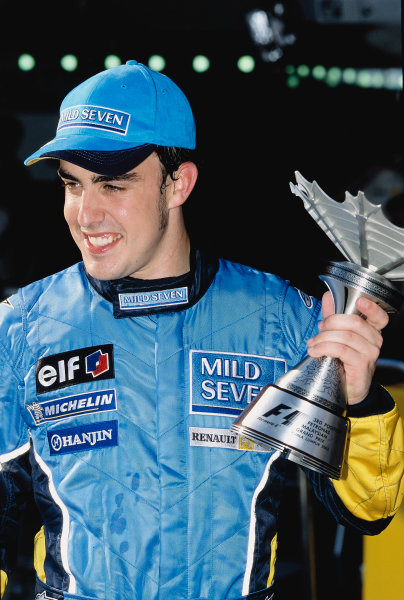 2003 Malaysian Grand PrixSepang, Malaysia. 21st - 23rd March 2003.Fernando Alonso, Renault R23, with his 3rd position trophy.World Copyright: Steven Tee / LAT Photographic ref: 35mm Imahe A21