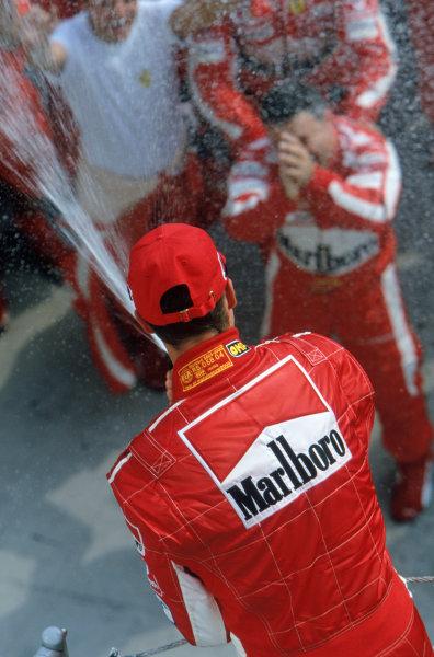 2005 Hungarian Grand Prix. Hungaroring, Hungary. 29th - 31st July 2005 Michael Schumacher, Ferrari F2005 celebrates his second position on the podium. World Copyright: Steven Tee/LAT Photographic Ref: 35mm Image A27