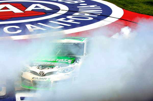 22-24 March, 2013, Fontana, California, USA Kyle Busch celebrates his win with a burnout ©2013, Nigel Kinrade LAT Photo USA