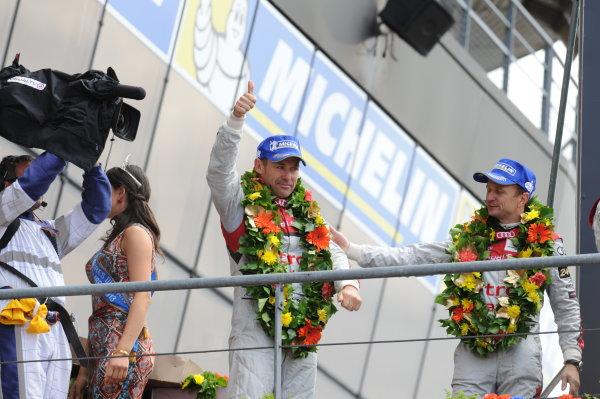 Circuit de La Sarthe, Le Mans, France. 21st-23rd June 2013. Tom Kristensen, Audi Sport Team Joest, No 2 Audi R18 e-tron quattro, on the podium. World Copyright: Jeff Bloxham/LAT Photographic ref: Digital Image DSC_9669