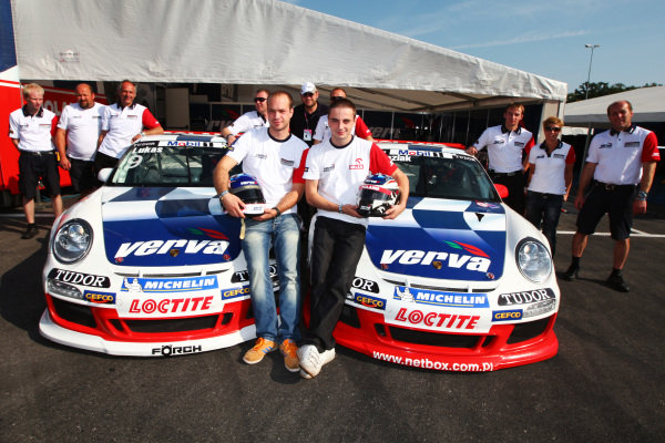 (L to R): Robert Lukas (POL) Verva Racing Team with team mate Kuba Giermaziak (POL) Verva Racing Team and the team. Porsche Supercup, Rd 9, Monza, Italy, 10-12 September 2010.