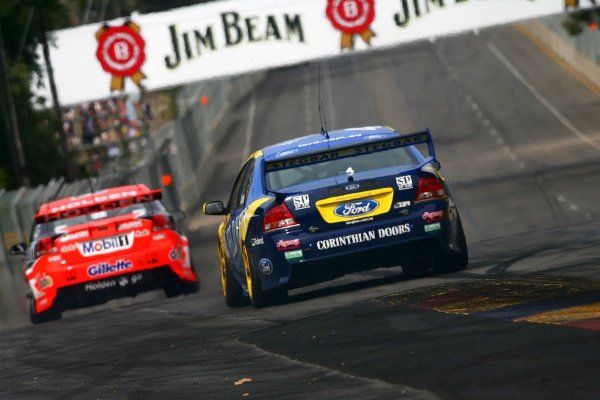 Todd Kelly (AUS) HRT Commodore is pursued by James Courtney (AUS) Jeld-Wen Ford Australian V8 Supercars, Rd1, Clipsal 500, Adelaide, Australia, 3-4 February 2007. DIGITAL IMAGE