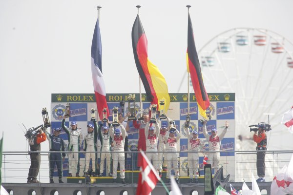 2006 Le Mans 24 Hours, Le Mans, France.14th - 18th June. LMP1 Podium. F Biela (DEU)/ E Pirro (ITA)/ M Werner (DEU), Audi Sport Team Joest. AND E Helary (FRA)/ S Loeb (FRA)/ F Montagny (FRA), Pescarolo Sport, Pescarolo Judd. and R Capello (ITA)/ T Kristensen (DNK)/ A McNish (GBR), Audi Sport Team Joest. celebrate there win  on the podium.World Copyright: Andrew Ferraro/LAT PhotographicRef: Digital Image Only ZP9O1517