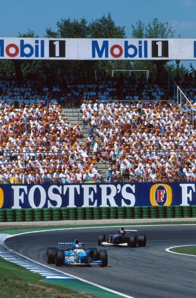Johnny Herbert (GBR) Benetton B195 leads local hero Heinz-Harald Frentzen.