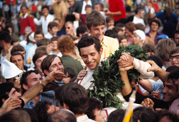 Winner Jacky Ickx swarmed by fans on the way back from the podium.