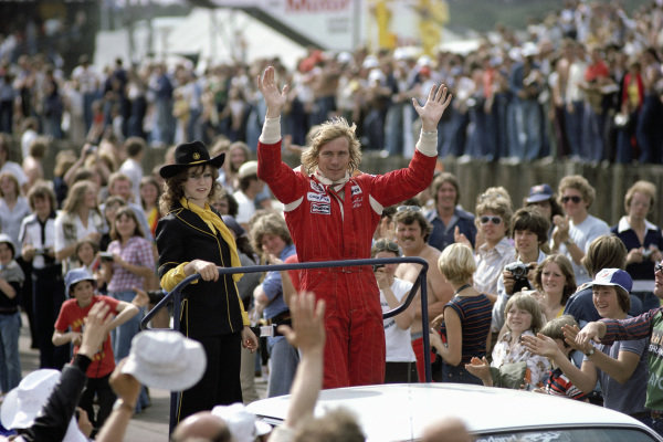 James Hunt waves to the crowd.