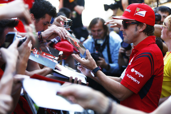 Circuit de Catalunya, Barcelona, Spain. Thursday 8 May 2014. Fernando Alonso, Ferrari, signs autographs for fans. World Copyright: Andy Hone/LAT Photographic. ref: Digital Image _ONY7764