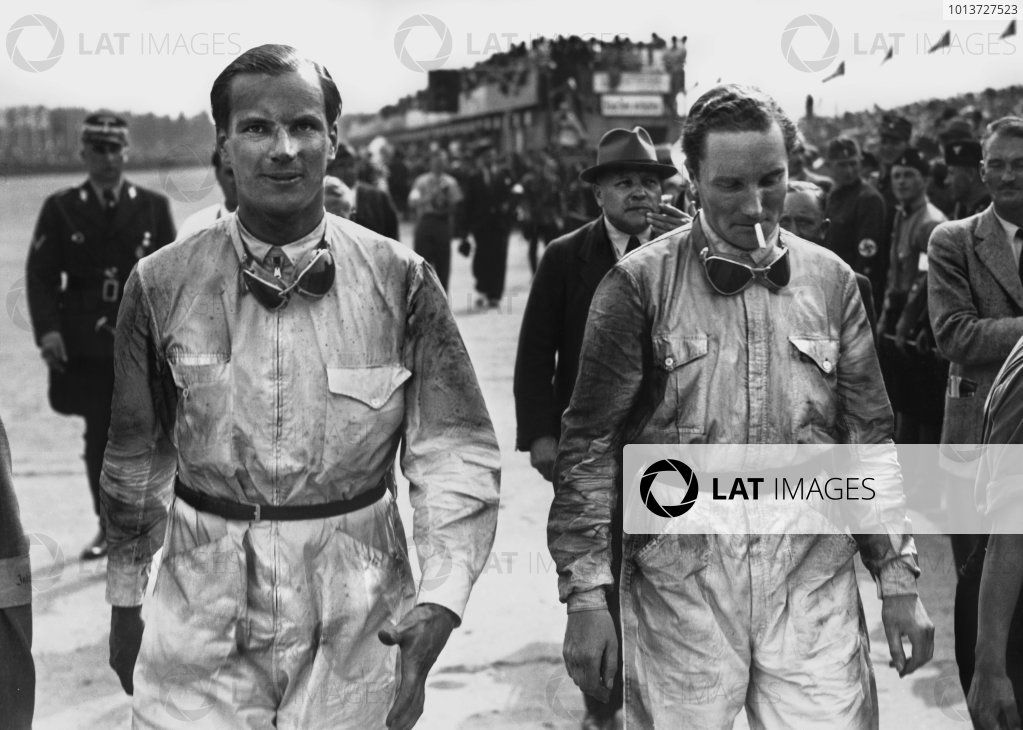 Nurburgring, Germany. 24th July 1938.Dick Seaman (Mercedes Benz W154) with team mate Manfred von Brauchitsch. Seaman would win the race, with von Brauchitsch retiring afer a crash.Ref: 38GER01World Copyright: Robert Fellowes/LAT Photographic
