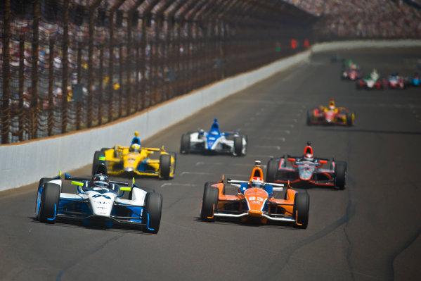 27 May, 2012, Indianapolis, Indiana, USATownsend Bell (#99), Charlie Kimball (#83), Ana Beatriz (#25), J. R. Hildebrand (#4), Takuma Sato (#15) and Sebastian Saavedra (#17) race into turn one.(c)2012, F. Peirce WilliamsLAT Photo USA