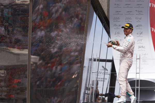 Circuit Gilles Villeneuve, Montreal, Canada. Sunday 7 June 2015. Lewis Hamilton, Mercedes AMG, 1st Position, sprays the victory Champagne. World Copyright: Steve Etherington/LAT Photographic. ref: Digital Image SNE20978