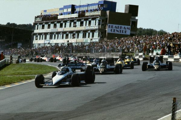 Brands Hatch, England.23-25 September 1983.Riccardo Patrese (Brabham BT52B BMW) leads Elio de Angelis (Lotus 94T Renault), Nelson Piquet (Brabham BT52B BMW) and Nigel Mansell (Lotus 94T Renault) through Paddock Hill Bend at the start.  Ref: 83EUR07. World Copyright - LAT Photographic