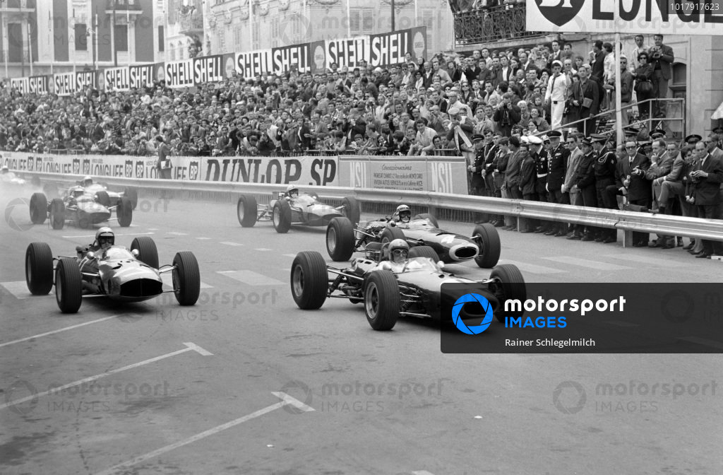 Jack Brabham, Brabham BT11 Climax, leads Lorenzo Bandini, Ferrari 1512, and Jackie Stewart, BRM P261, at the start.