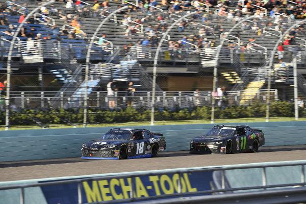 #18: Harrison Burton, Joe Gibbs Racing, Toyota Supra iK9 and #11: Justin Haley, Kaulig Racing, Chevrolet Camaro LeafFilter Gutter Protection