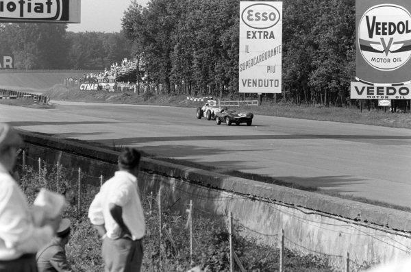 John Lawrence, Ecurie Ecosse, Jaguar D-Type, leads Jimmy Bryan, Dean Van Lines, Kuzma Offenhauser.
