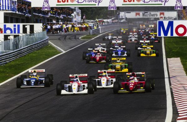 Mika Häkkinen, McLaren MP4-8 Ford, leads Jean Alesi, Ferrari F93A, Ayrton Senna, McLaren MP4-8 Ford, and Alain Prost, Williams FW15C Renault, at the start.