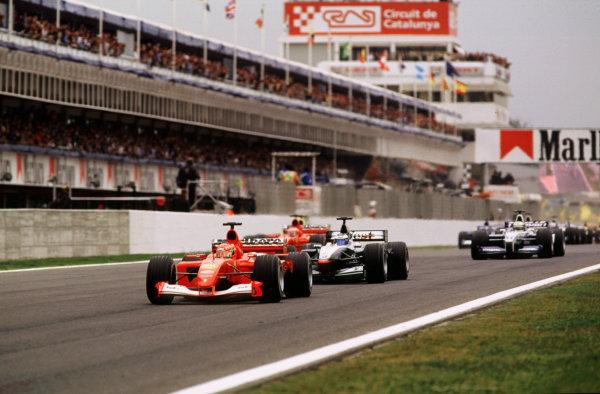 2001 Spanish Grand PrixCatalunya, Barcelona, Spain. 27-29 April 2001.Michael Schumacher (Ferrari F2001) leads from Mika Hakkinen (McLaren MP4/16 Mercedes) and Rubens Barrichello (Ferrari F2001) at the start.World Copyright - LAT Photographicref: 35mm Image