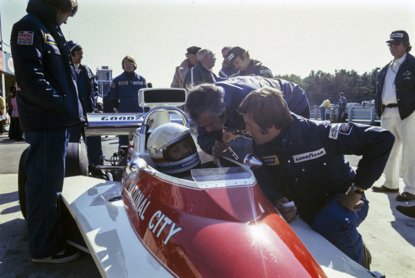 Team boss Roger Penske talking to Mark Donohue in the pits.
