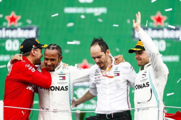 Sebastian Vettel, Ferrari, Race winner Lewis Hamilton, Mercedes AMG F1 and Valtteri Bottas, Mercedes AMG F1 celebrate on the podium
