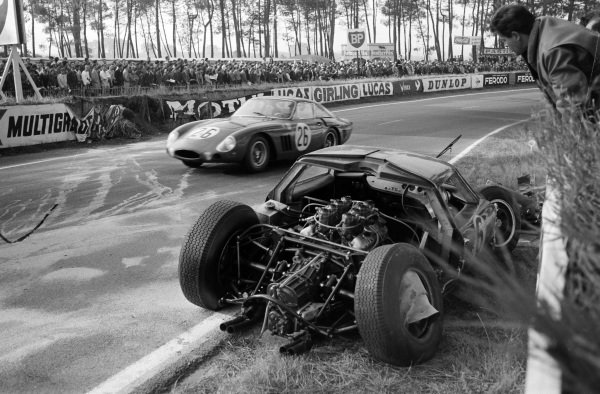 David Piper / Masten Gregory, North American Racing Team, Ferrari 250GTO, passes the crashed car of David Hobbs / Richard Attwood, Lola Cars, Lola Mk6 GT-Ford.