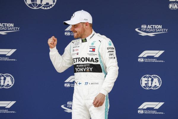 Valtteri Bottas, Mercedes AMG F1 celebrates pole position in Parc Ferme
