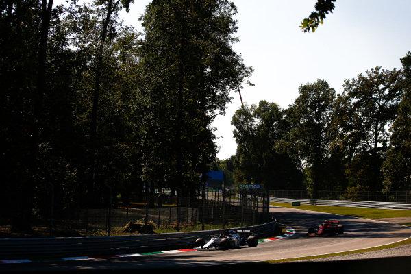 Daniil Kvyat, AlphaTauri AT01, leads Charles Leclerc, Ferrari SF1000