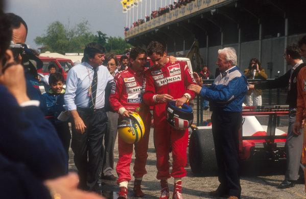 1991 San Marino Grand Prix.Imola, Italy. 26-28 April 1991.Ayrton Senna, 1st position chats to teammate Gerhard Berger, 2nd position in parc ferme after the race. FIA Race Starter Roland Bruynseraede walks along with them. Ref-91 SM 14.World Copyright - Hallbery/LAT Photographic