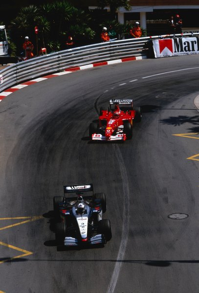 2002 Monaco Grand Prix.Monte Carlo, Monaco. 23-26 May 2002.David Coulthard (McLaren MP4/17 Mercedes) leads Michael Schumacher (Ferrari F2002) out of the Grand Hairpin. They finished in 1st and 2nd positions respectively.Ref-02 MON 04.World Copyright - LAT Photographic