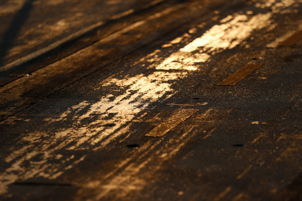 Hungaroring, Budapest, Hungary. Friday 24 July 2015. Track surface detail as the sun rises. World Copyright: Charles Coates/LAT Photographic ref: Digital Image _N7T6215