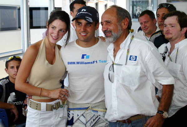 Race winner Juan Pablo Montoya (COL) Williams celebrates victory with Connie Montoya (COL) and his father Pablo Montoya (COL).