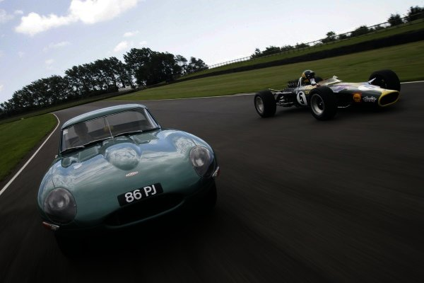 2007 Goodwood Revival Press Day. Goodwood, West Sussex. 18th July 2007. Lotus 49b and Jaguar E-Type. Tracking photo. World Copyright: Gary Hawkins/LAT Photographic. Ref: Digital Image Only.