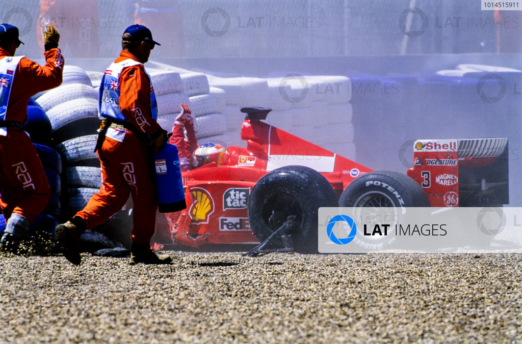 1999 British Grand Prix. Silverstone, England. 9th - 11th July 1999. Michael Schumacher (Ferrari F399), crashes heavily into the tyre barriers at Stowe on the first lap, breaking his leg. World Copyright: LAT Photographic.  Ref:  99_GB_MS_Crash_02.